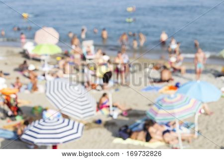 Mediterranean beach with the colorful umbrellas - blurred image