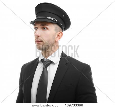 Young chauffeur standing on white background