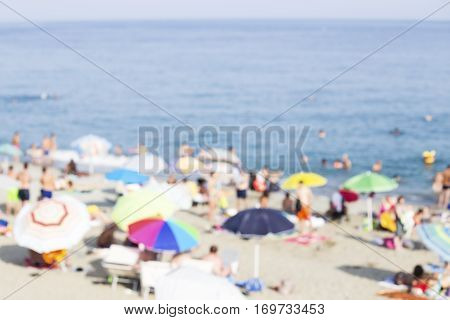 The Mediterranean beach with the colorful umbrellas - blurred image
