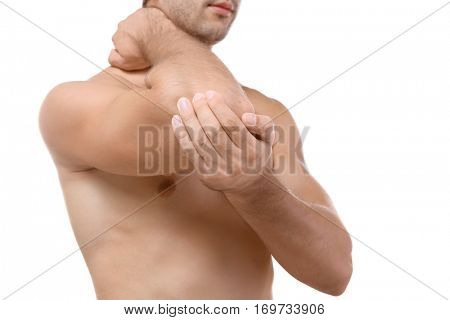 Young man with pain in elbow isolated on white