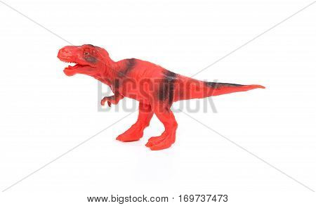 red and black tyrannosaurus toy on a white background