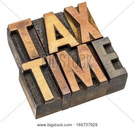 tax time banner - isolated word abstract in vintage letterpress wood type printing block stained by color inks