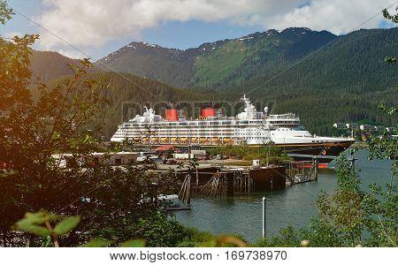 Cruise ship in Alaska port on day. Tourism on cruise line to alaska mountain