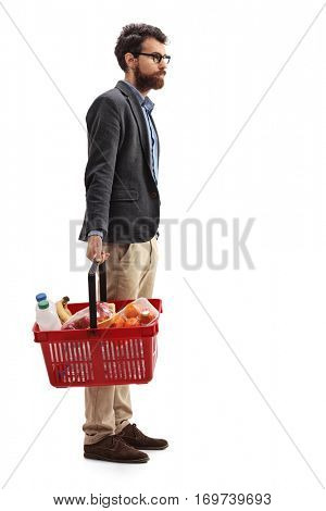 Full length portrait of a man with a shopping basket full of groceries waiting in line isolated on white background