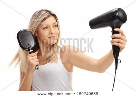 Woman blow drying her hair isolated on white background