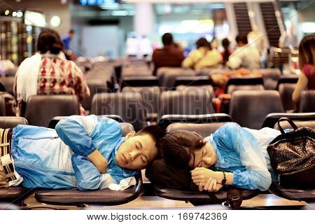 BangkokThailand-June 12016 Passengers wait for flights Exhausted and fell asleep continuity and on the chair seat stay within the Donmung International Airport Thailand