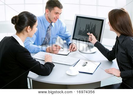 Portrait of three businesspeople discussing plan at meeting