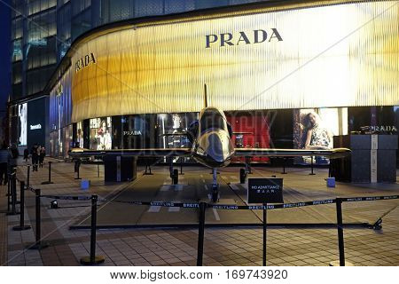 BEIJING - FEBRUARY 23: Breitling model aircraft on display outside Italian apparel and accessories house Prada in Beijing China, February 23, 2016.