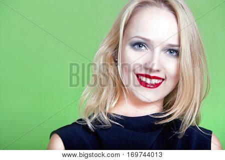 Sexy blonde woman on green background