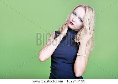Sexy blonde businesswoman with hands in her hair