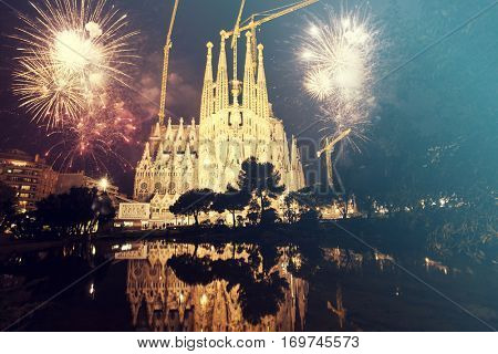 Sagrada Familia with fireworks, celebration of the New Year in Barcelona, Spain