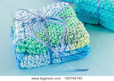 Homemade crocheted dishcloths tied up with ribbon as gifts.