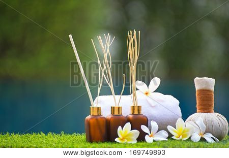 Spa treatment and product for hand and foot spa with flowers and water white frangipani flowers Thailand. Greenery tone 2017