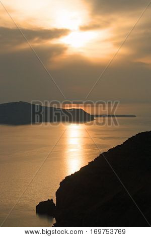 Watching the sunset over the Aegean Sea on the Island of Santorini, Greece