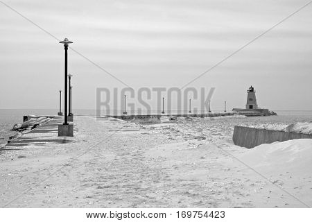 Lighthouse and pier on Lake Erie on a cold, winter day
