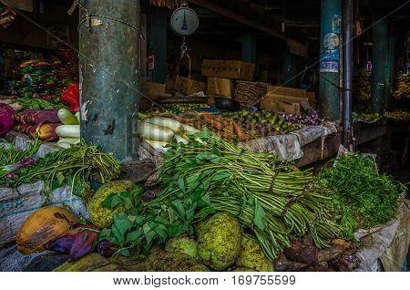 Market food street in Asia. Vegetables on market in Sri Lanka. Tropical fruit farmers. Outdoor market in Sri-Lanka. Buying oriental food.