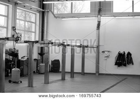 Empty hoists at automobile repair shop