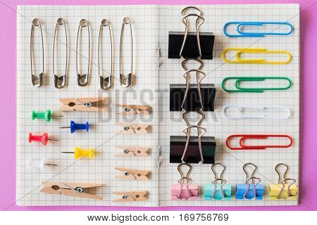 Pins and paper clips collection, pink background
