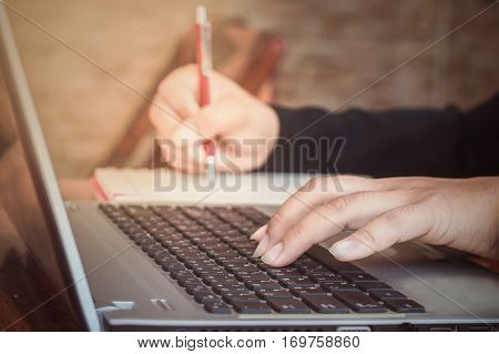 Close up of woman's hand typing on a keyboard