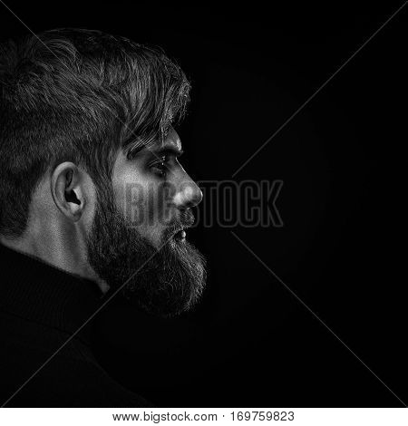 Black And White Close Up Image Of Serious Brutal Bearded Man On Dark Background
