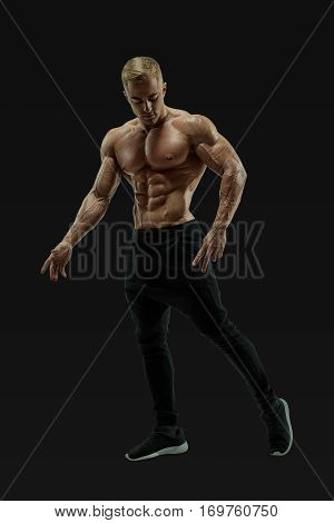Full-length Shot Of Young Man With Muscular Body
