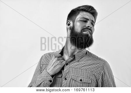 Black And White Portrait Of Bearded Man In Remorse Or Regret
