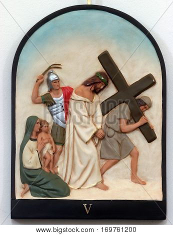 HRVATSKA DUBICA, CROATIA - NOVEMBER 18: 5th Stations of the Cross, Simon of Cyrene carries the cross, Parish Church of Holy Trinity in Hrvatska Dubica, Croatia on November 18, 2010.