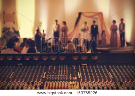 Professional audio mixing console playing music on wedding ceremony