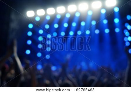 Blurred background of a crowd at a open air concert