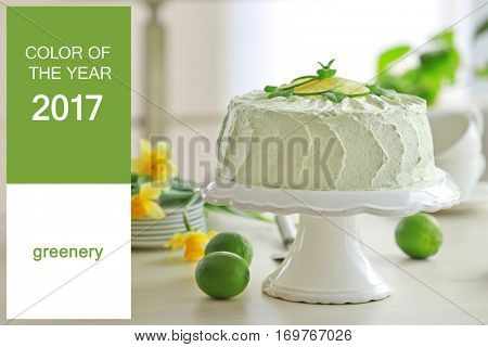 Trendy color concept. Tasty cake on stand. Text COLOR OF THE YEAR 2017 GREENERY on background