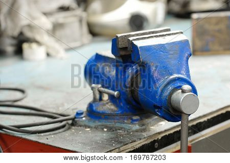 Vise on a working bench in a car reoair station