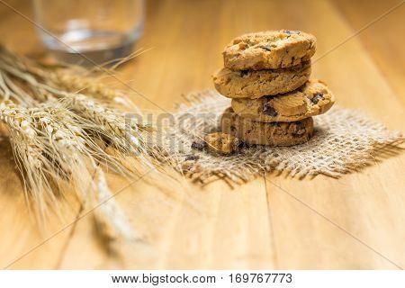 Chocolate Cookies On A Cloth Sack On Wood.
