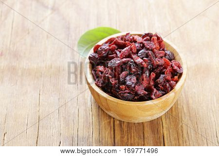 Dried berries red cranberries on a wooden table