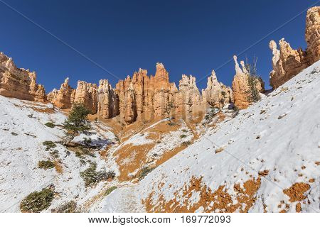 Hoodoo towers and snow at Bryce Canyon National Park in Southern Utah.