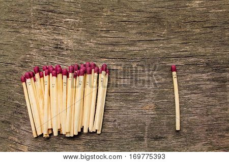 Matches on wooden background. Concept of loneliness, allocation from crowd.