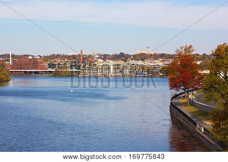Potomac River waterfront near Georgetown Park Washington DC USA. Autumn in US capital suburb near the river.