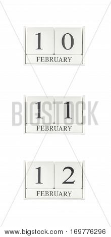 Closeup group of white wooden calendar with black 10 11 12 february word three date calendar isolated on white background