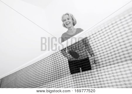 Senior female table tennis player laughing