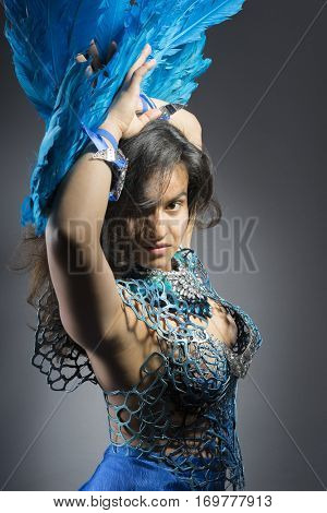 Dancer, Brunette woman in costume made of blue feathers, wild and free bird, fantasy image