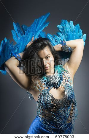 Free, Brunette woman in costume made of blue feathers, wild and free bird, fantasy image