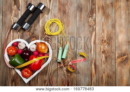 Sport And Diet. Vegetables, Dumbbells  Centimeter. Peppers, Tomatoes, Garlic, Onions,  Radishes In T