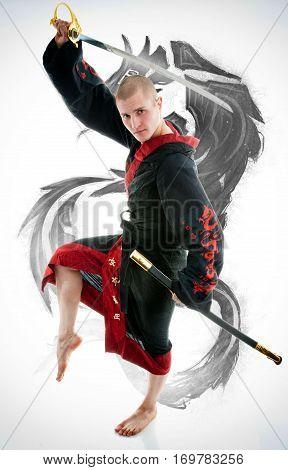 Man dressed in black dragon kimono demonstrating martial arts combat