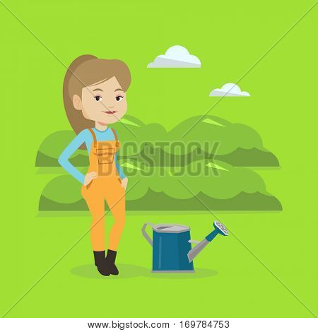 Cheerful caucasian female farmer standing near a watering can on the background of agricultural field with green bushes. Woman watering plants in garden. Vector flat design illustration. Square layout