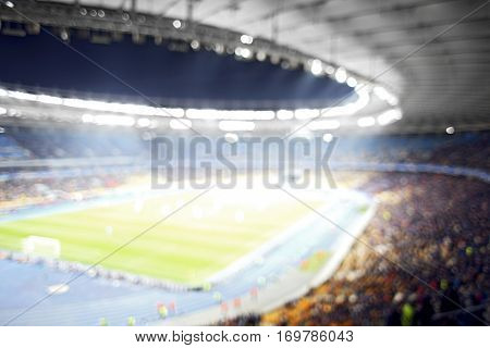 Panoramic view of modern stadium during football match, blurred background