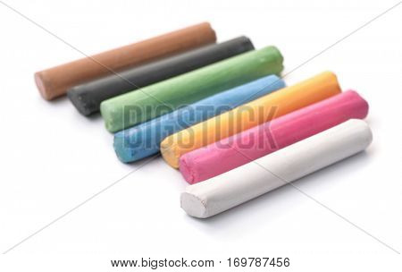 Row of oil pastel sticks isolated on white