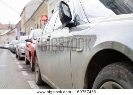 Close up picture of luxurious car in a parking space on the center of the city
