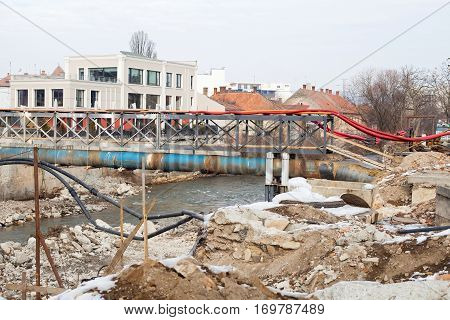 Picture of a broken bridge in construction in the center of Cluj-Napoca