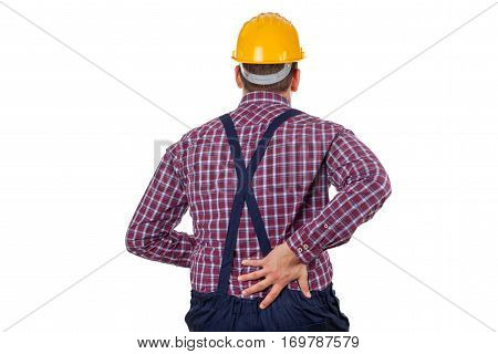 Picture of a young male engineer having backpain