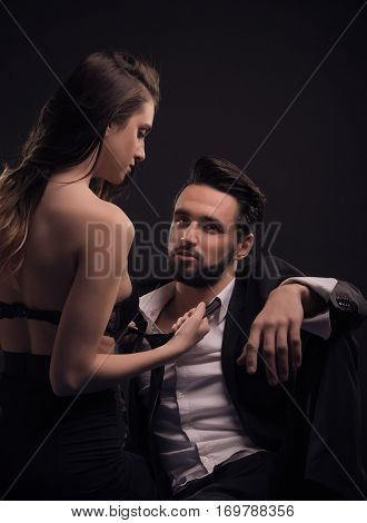 Young Couple Woman Pulling Man Tie