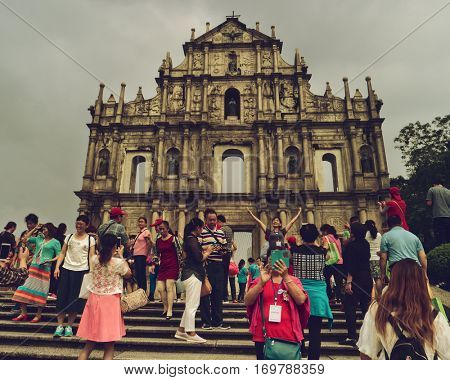 Macao - October 2016: People in front of Famous Ruins of St. Paul's Church. Retro look.